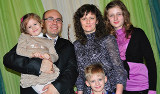 Roman Pivoshenko with his family